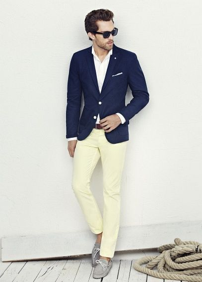 Shop this look on Lookastic: https://lookastic.com/men/looks/blazer-dress-shirt-chinos-boat-shoes-belt-sunglasses/12275   — Black Sunglasses  — White Dress Shirt  — Navy Blazer  — Dark Brown Leather Belt  — Yellow Chinos  — Grey Leather Boat Shoes