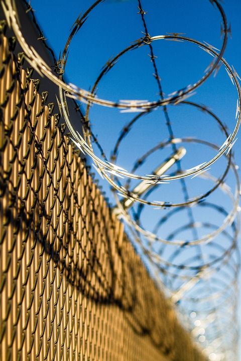 tight security high tension barb or razor wire added to a fence provides