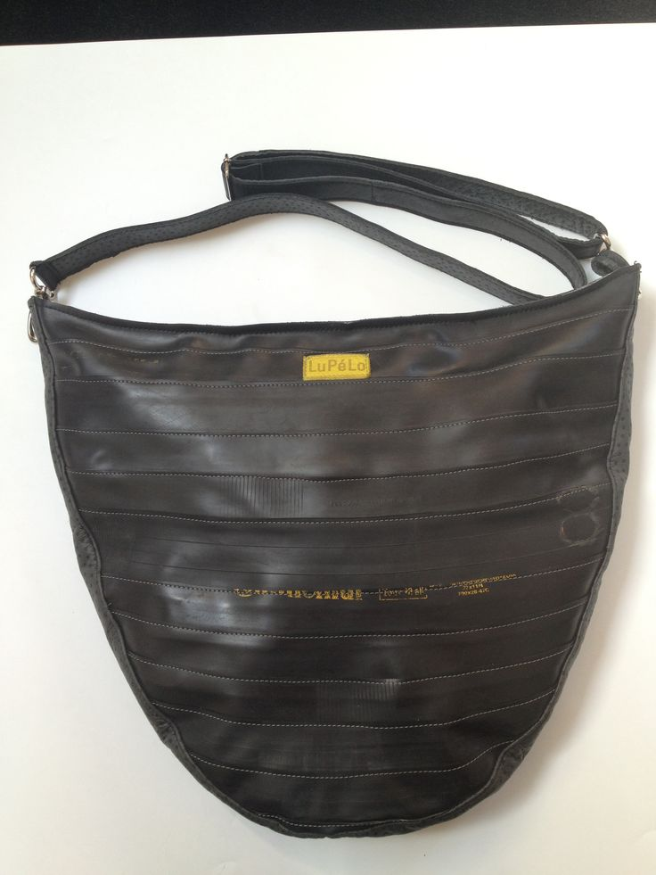 Shoulderbag, made of used bicycle-innertubes with black leather.