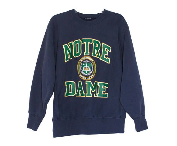 Vintage 90s Notre Dame Fighting Irish Crewneck Sweatshirt Unisex Adult Size Large ..::HISTORY::..  The University of Notre Dame du Lac, or simply Notre Dame, is a Catholic research university located adjacent to South Bend, Indiana, in the United States. In French, Notre Dame du Lac means Our Lady of the Lake and refers to the universitys patron saint, the Virgin Mary. The main campus covers 1,250 acres in a suburban setting and it contains a number of recognizable landmarks, such as the…