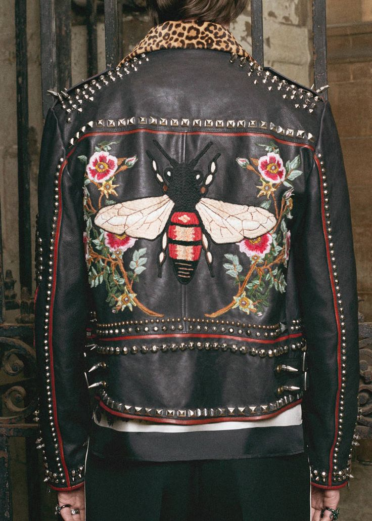 Gucci DIY: Championing the idea of self-expression, Alessandro Michele hands over the design reins, courtesy of the Do It Yourself service. Symbols, including a bee, daggered heart and kingsnake can be embroidered onto the sleeve of knit or shirt. Colorful printed silks are on offer as tailoring linings, and initials can be appliquéd onto bombers, leather jackets and the Ace sneaker.