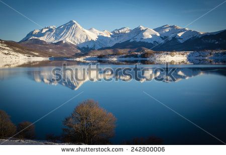 A view of Campotosto lake in Winter, Abruzzo - Italy. #Winter #Holidays #Lake #Campotosto #Abruzzo #Park #GranSasso #MontiDellaLaga #Outdoor #Snow #Snowy #Landscape #Card #Wallpaper #ambient #Reflects