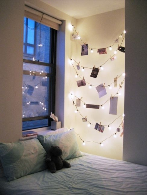 Use christmas lights with clothespins to hang photographs. Cute!