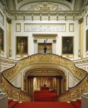 Inside the Buckingham Palace, the Grand Staircase: The palace is over 300 years old. In 1761, King George III purchased the property for his wife Queen Charlotte. It was originally named Buckingham House. Buckingham House was transformed into Buckingham Palace in the 1820s by the architect John Nash for George IV. Later architect Edward Blore took over when Nash was dismissed for going over budget.