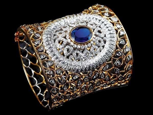 A royal figureDesigned by Dwarkadas Chandumal Jewellers, this luxurious cuff is set with a deep blue sapphire and complementing white diamonds.