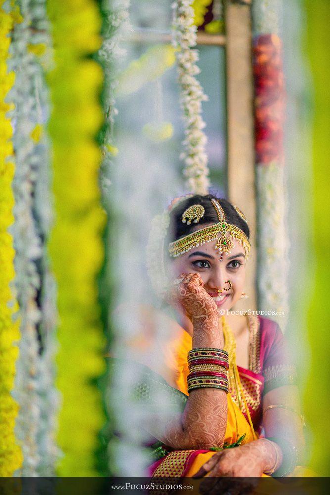 South Indian bride. Kanchipuram silk sari. Temple jewelry. Flower garlands.