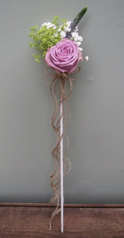 Flower girl wand with a lilac rose and natural binding