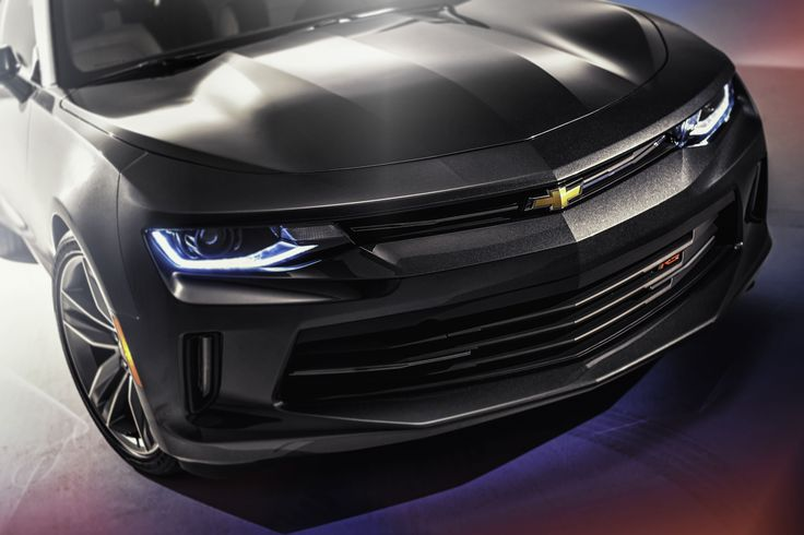 2016 Chevy Camaro   - RoadandTrack.com. The dark blue with charcoal grey vinyl, or vice versa, would look pretty snazzy!