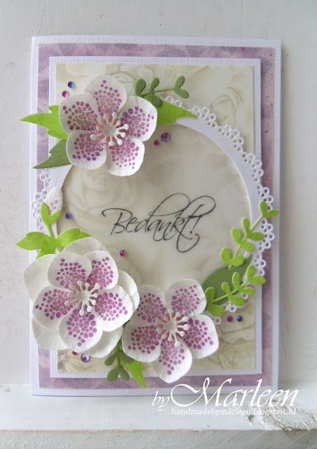 Card by DT member Marleen with Collectables Eline's Helleboras (COL1394), Eline's Poinsettia (COL1393) and Craftables Basic Round (CR1331) by Marianne Design: