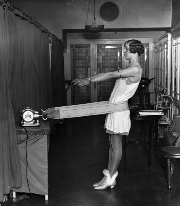 """Ha. Right. A women uses a vibrating """"hip trimming"""" belt in 1928. Sports footwear by Mrs. Claus. 