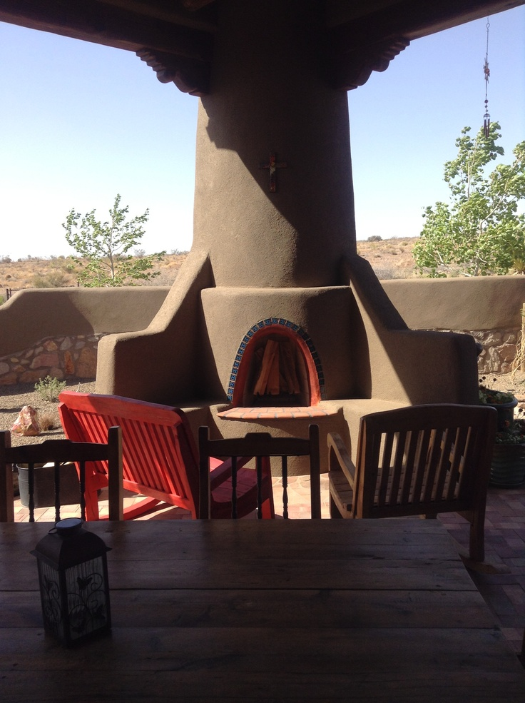 Outdoor kiva fireplace lovely southwestern home for Kiva fireplaces