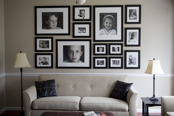 We have something similar to this at my house, all of our pictures from birth to now...this is a MUST in my future home, I love looking at memories when im walking through the house