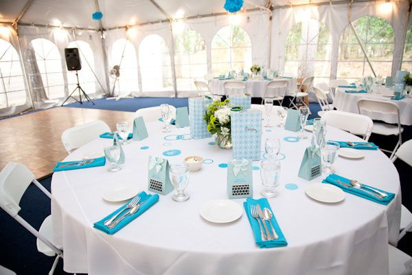 Table setting white clothes with blue napkins