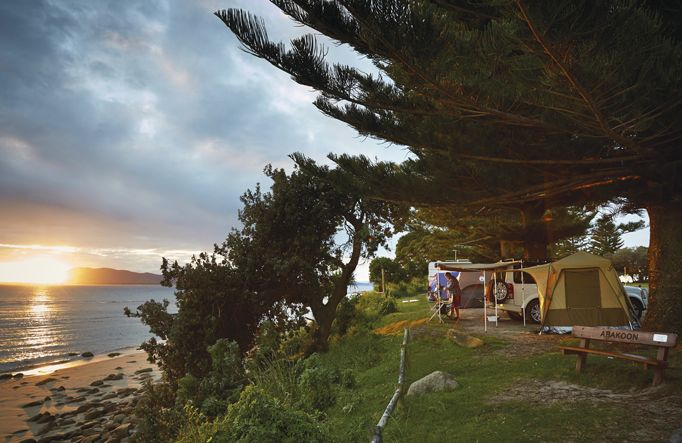 Need a break? Pitch a tent or park your caravan by the beach at one of these popular national park campgrounds on the NSW North Coast.