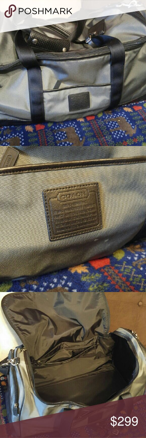 Authentic Coach duffle Authentic grey and black Coach luggage. Duffle bag style with 2 side pockets, small front pocket, large back pocket. This bag is in great condition- barely every used. Coach Bags