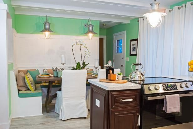 As seen at HGTV.com, this crisp contemporary kitchen and dining room area makes a statement with lime green walls and built-in banquette seating.