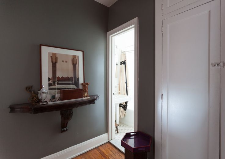 This small dressing room separates the main living space and the bathroom.