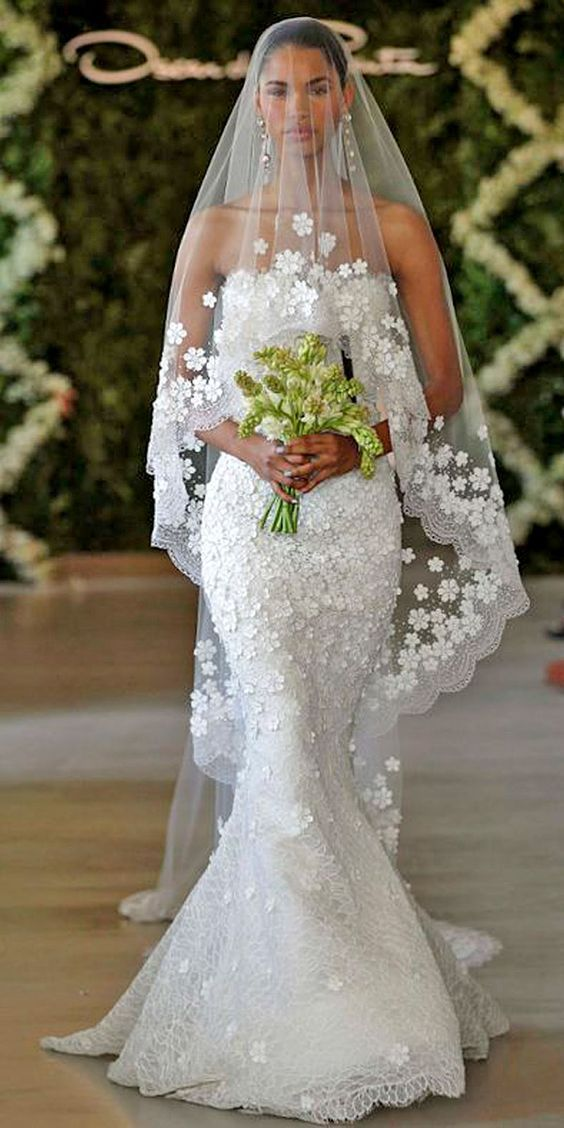 Choose the right veil for your body type. Floral applique wedding dresses and bridal veils are so feminine, elegant and also in trend for this year - Oscar de la Renta.