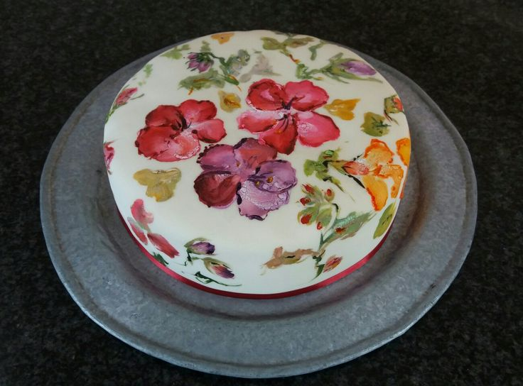 Delicious light American fruit cake studded with colourful glazed fruit soaked with brandy, sherry and rum and hand-painted in jewel-like colours. Yum!
