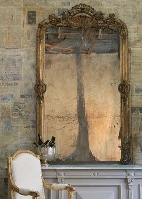 Mirror ~ love the stone wall too! on second look, I think this wall is covered with newspapers, magazine pages,  et cetera!  I like!