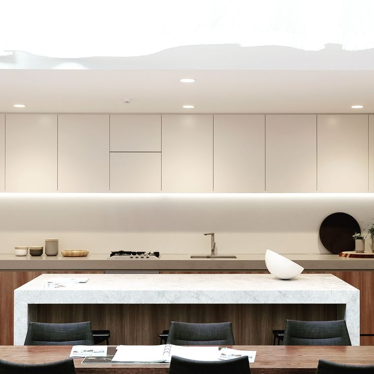Apartment kitchen bench & island. Warm colour tones, natural materials & atmostoheric light playing well together.    St Boulevard  - Architectural & Interior Design by Elenberg Fraser.