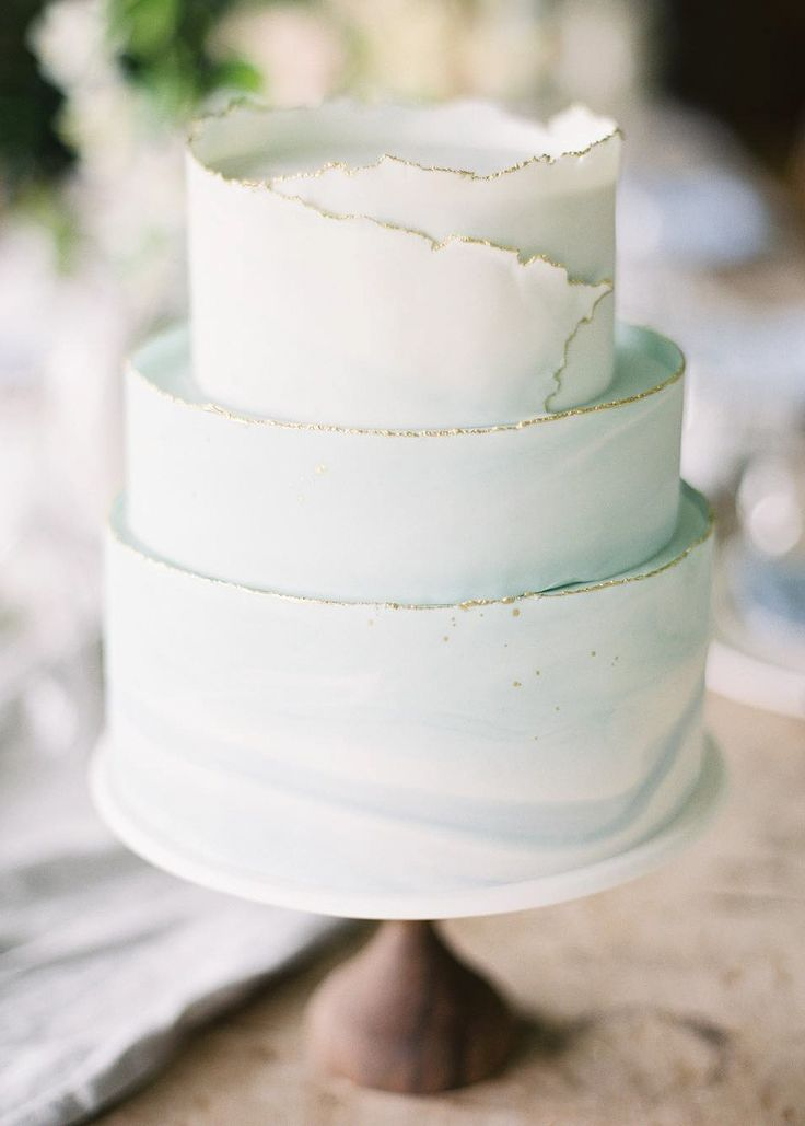 A delicate, minty-blue cake with a unique touch on the top!