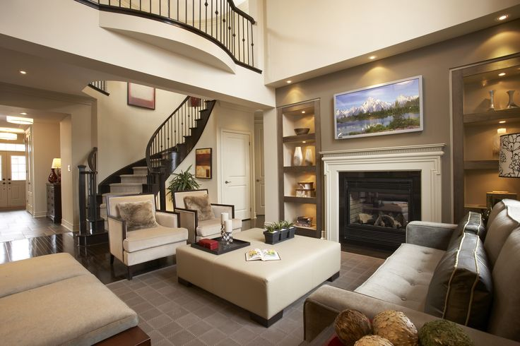 high ceiling family room with fireplace loft balcony and built in