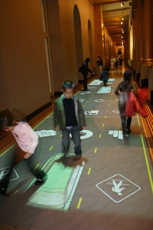 Transportation Hall, National Building Museum, Installation with an interactive floor using full-body interaction.  http://www.potiondesign.com/project/transportation-hall