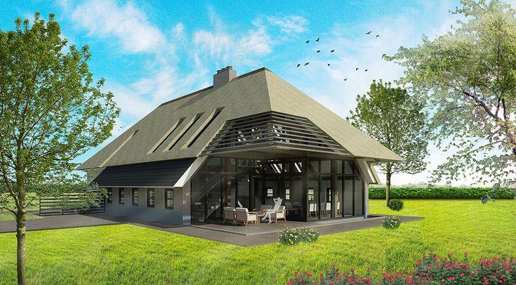 Veel daglicht in moderne boerderij door grote ramen en dakramen.