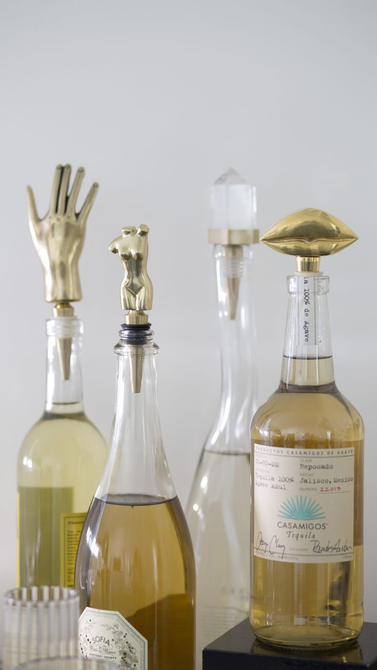 KELLY WEARSTLER | WINE STOPPERS. Hand-sculpted from natural bronze