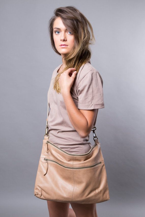 This handmade soft tan nude leather bag, can be carried cross-body, on shoulder, or without the strap as oversize purse under arm, crafted in rich soft