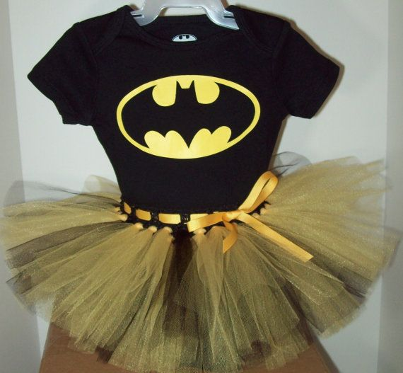 "Super cute ""Batman"" tutu and onesie for your little batgirl princess! Available in CassieCottage at Etsy.com. Sizes 0/3 months to 24 months for $29.99."