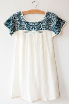 Beautiful teal color and embroidery. I love the breezy-looking material. So summery!