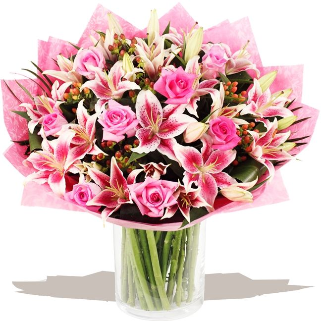 Deluxe Pink Lily & Rose Hand-tied  A deluxe, extra large hand-tied bouquet of pink large head Roses styled in the hand with with glorious sprays of pink Oriental Lilies, plump Hypericum berries and finished with tropical leaves. #wedding #flowers