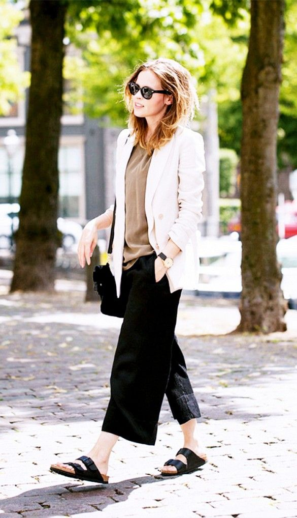 Wide-leg cropped trousers, white blazer, and Birkenstocks.