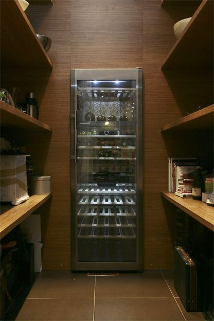 Pantry with built in wine-fridge. Incredible use of space. Where else would you store your wine?