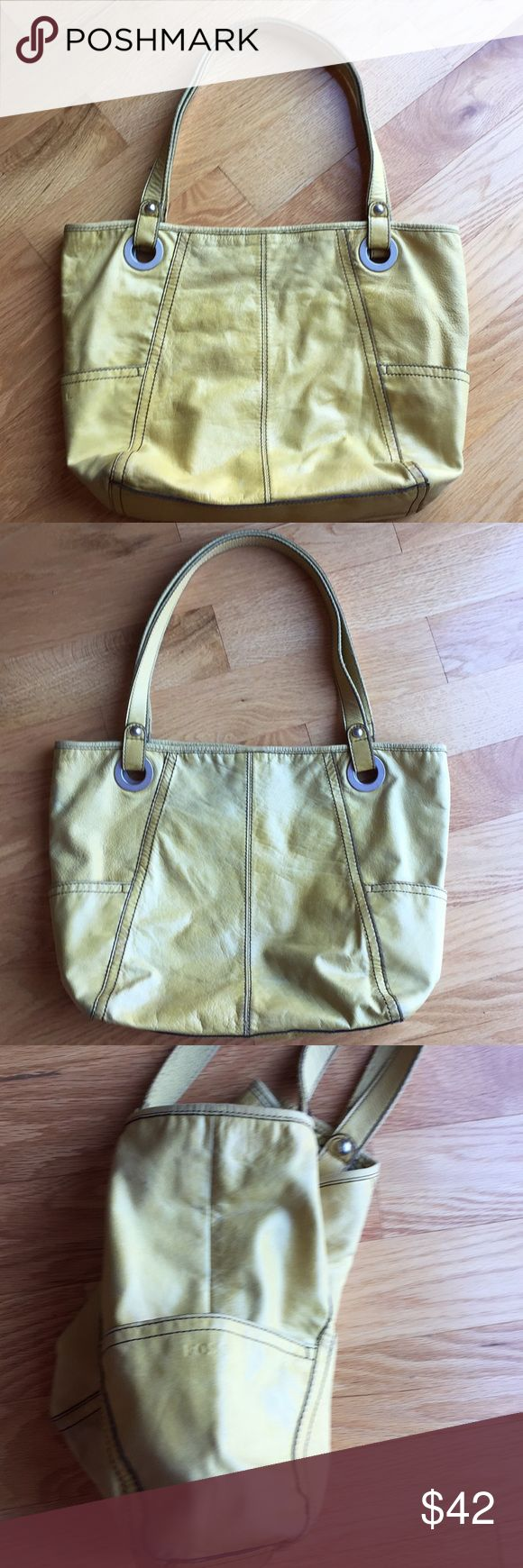 Fossil yellow shoulder bag Beautiful mustard yellow leather fossil purse. This purse has been used but has lots of life left in it. It is still in very good condition. It has a distressed look to it and silver hardware.It measures 17 inches across and 13 inches top to bottom. There is a zippered pocket on the inside as well as other pockets on the opposite side very roomy. A very unique color and rare to find! Please ask any questions! Fossil Bags Shoulder Bags