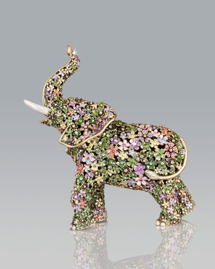 "Handcrafted elephant figure. Cast metal. Embellished with hand-applied layers of jewel-tone enamel and Swarovski crystals. 6.25""W x 3.25""D x 7""T. Made in the USA."