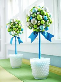TOTALLY making this for Christmas decorations. Making ribbon topiaries for the wedding.