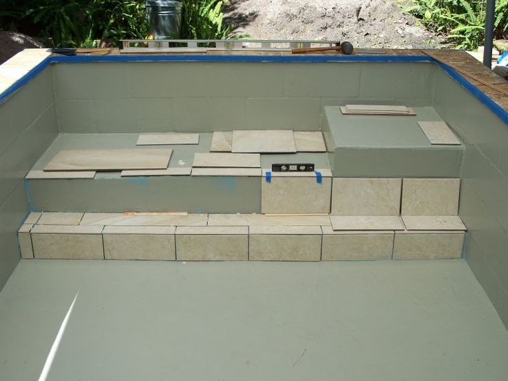 Concrete block pools re concrete block puppy pool in for Cinder block pond ideas