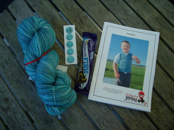 """Winter Yarn Club 2012 - June (Mermaids and Mermen) Boys Package includes: """"Trident"""" yarn, Buttons by Benji, Chocolate fish and """"Poseiden"""" vest pattern by Amber Bertram 