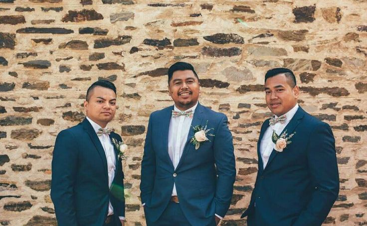 Groomsmen suits and floral bowties #groomsmen #buttonholes #suits #floralbowties #custommade #navysuits #mintgreen #weddingphotos #weddingday