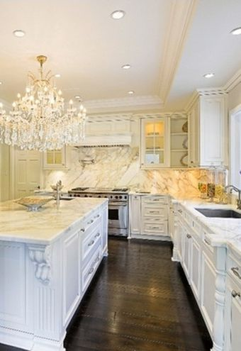 Gleaming white cabinets and a black floor inside Zoe Saldana's new kitchen.