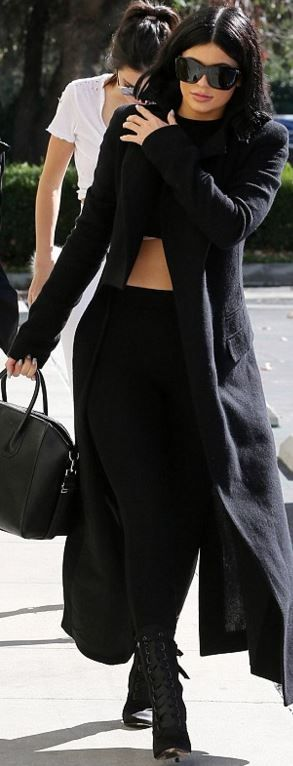 Who made Kylie Jenner's velvet boots, black leather handbag and boots?