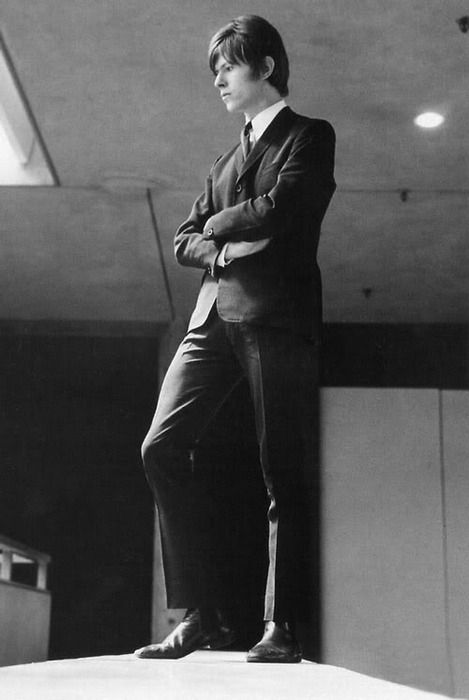 A brooding sharp suited David Bowie in his mod days