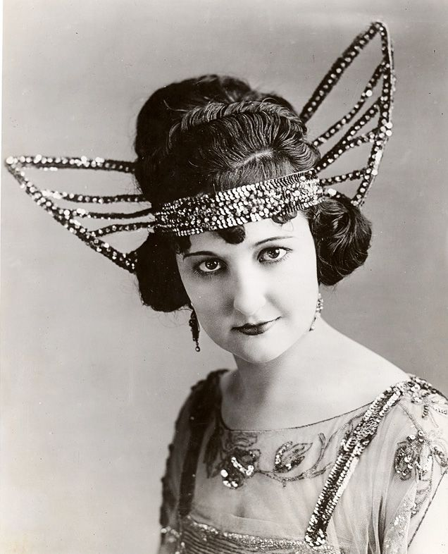 Flapper girl - looking beautiful with her sequined butterfly headdress. How I adore the 1920's....