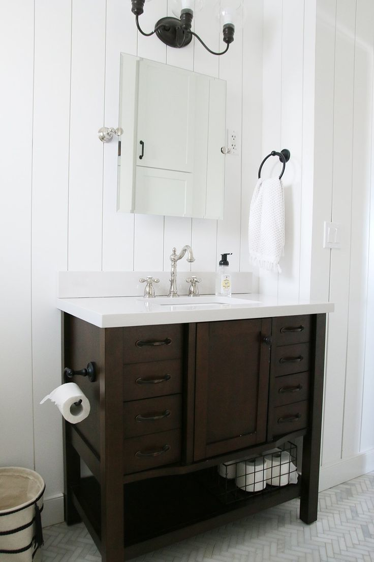 If you have a small bathroom, installing a vanity with some legs to it will really help open up the space.