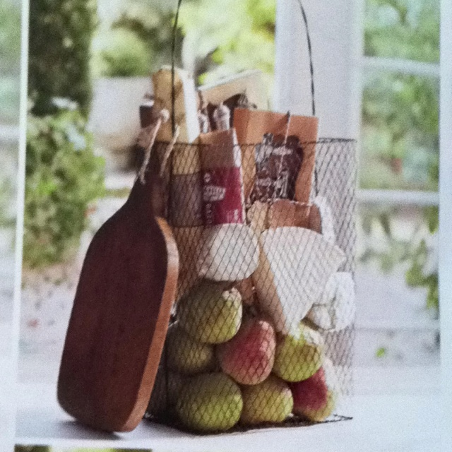 "oh that's lovely! Especially with local pears!  yum!  the white ""cheese triangle"" and circle really look great with the wood and wire basket. love this natural idea!"