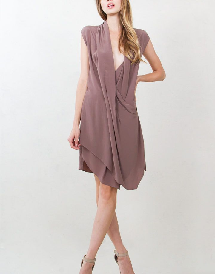 Taupe cap sleeve draped dress with a wrap front and layered hem.