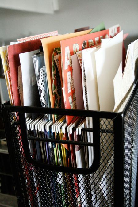 Organize paper scraps by color in a wire mesh hanging file folder dealie. This might solve my paper scrap problem.